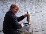 John Flecture takes a 2 lb plus chub at the Dam.JPG